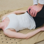woman having thai yoga massage