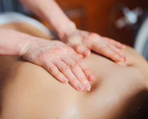 Woman having spa body massage treatment in the spa